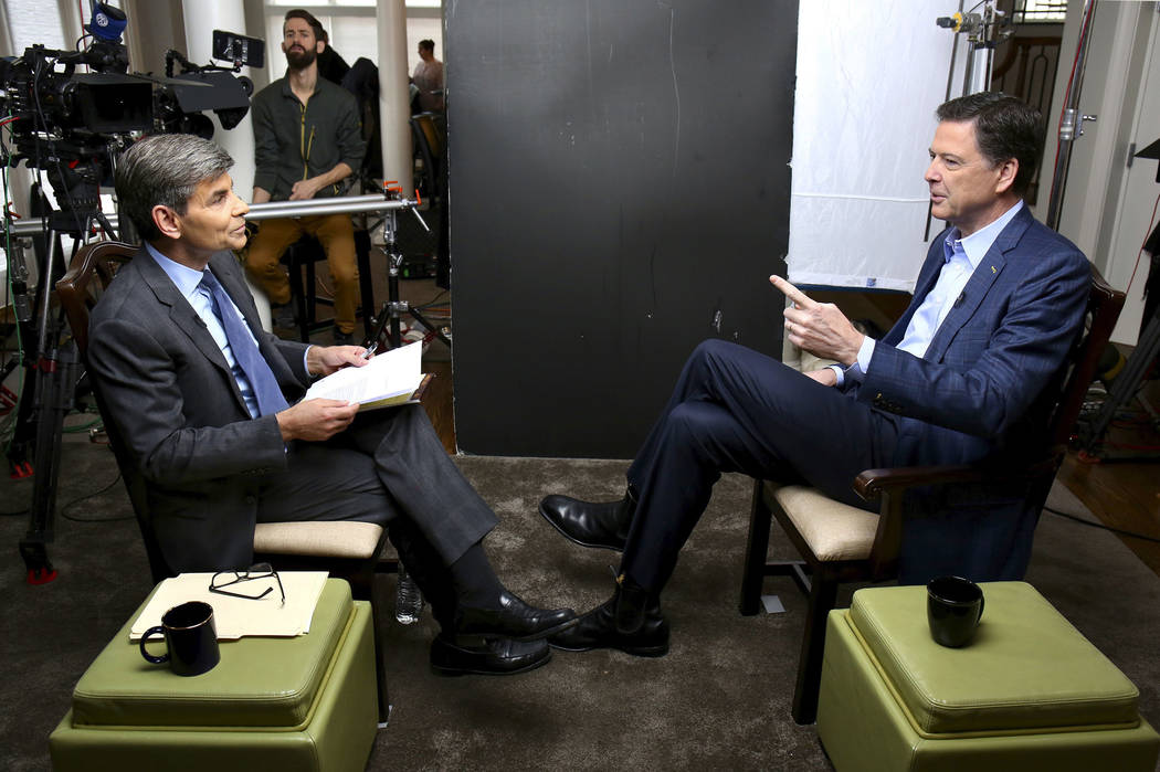 "Correspondent George Stephanopoulos, left, appears with former FBI director James Comey for a taped interview that aired during a primetime ""20/20"" special on Sunday, April 15, 2018 on the ABC Tel ..."