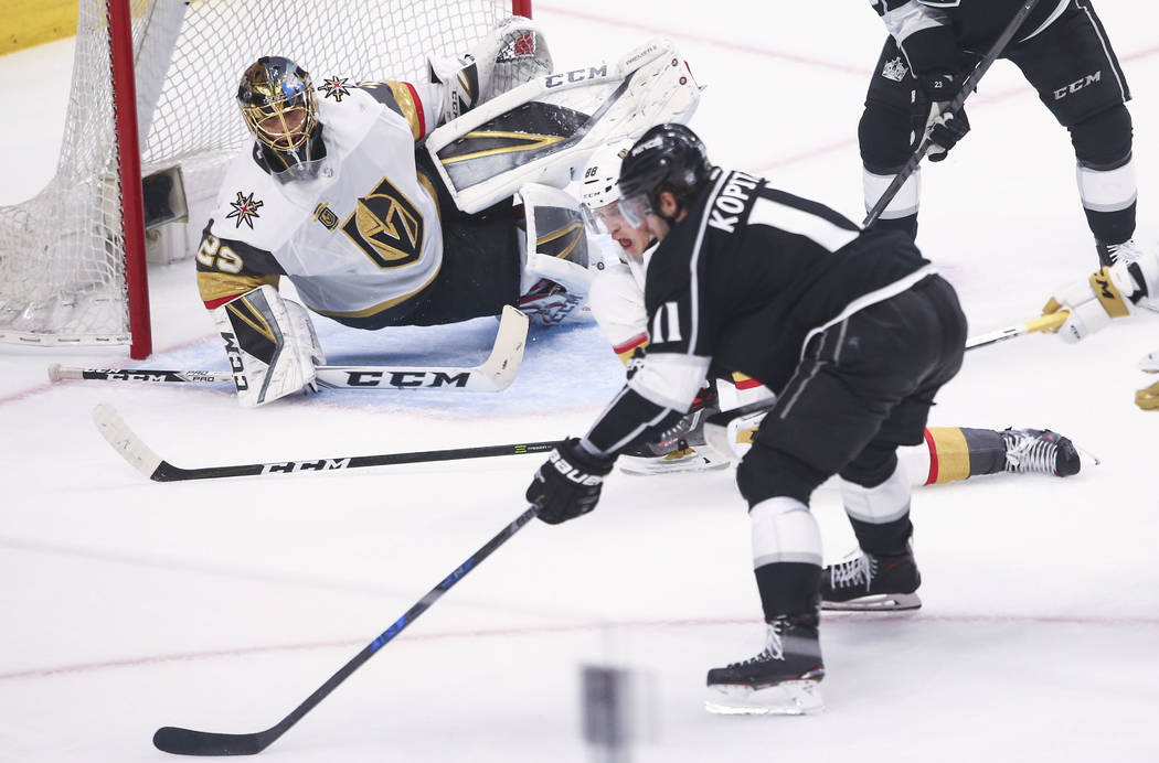 Los Angeles Kings center Anze Kopitar (11) lines up his shot as Golden Knights goaltender Marc-Andre Fleury (29) defends during the first period of Game 3 of an NHL hockey first-round playoff seri ...