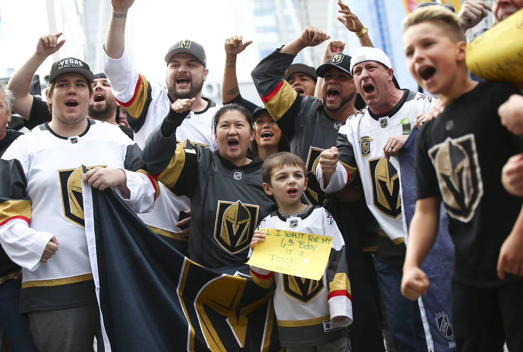 Golden Knights fans cheer outside of the Staples Center ahead of Game 3 of their NHL hockey first-round playoff series against the Los Angeles Kings in Los Angeles on Sunday, April 15, 2018. Chase ...