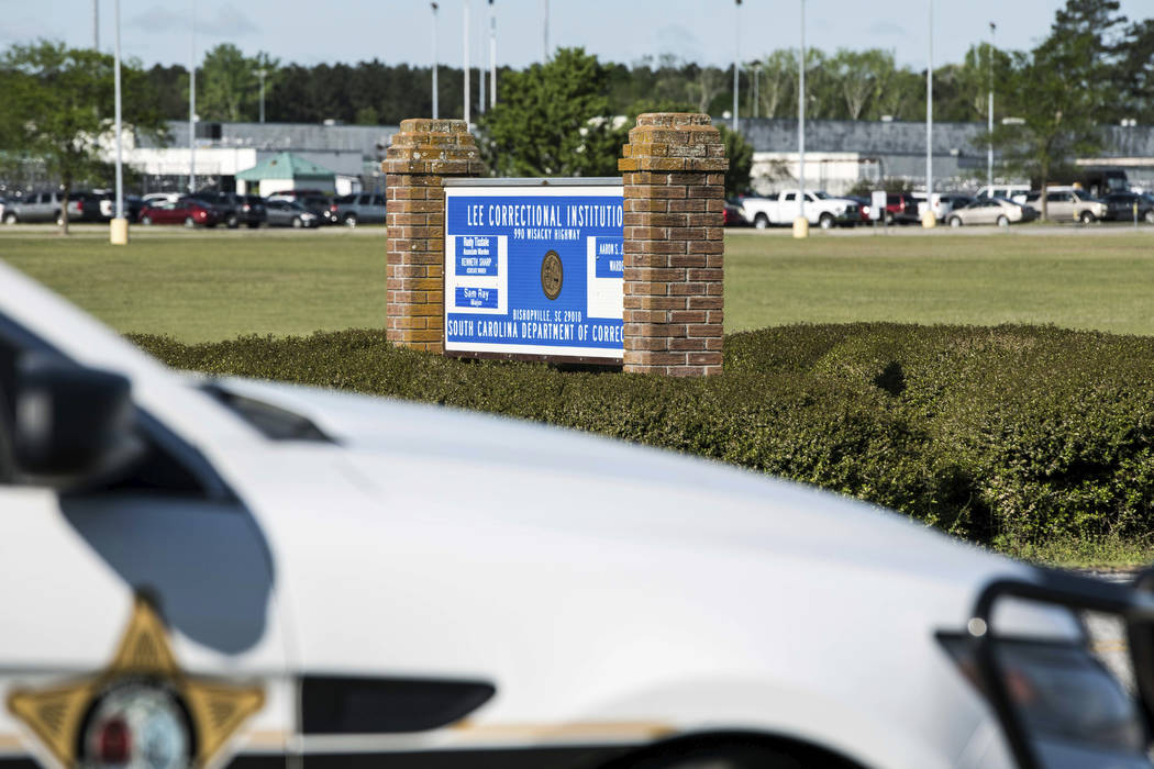 A police vehicle sits outside the Lee Correctional Institution on Monday, April 16, 2018, in Bishopville, S.C. Multiple inmates were killed and others seriously injured amid fighting between priso ...
