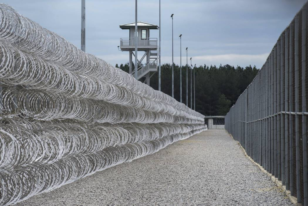 FILE - In this Feb. 9, 2016, file photo, razor wire protects a perimeter of the Lee Correctional Institution in Bishopville, S.C. A South Carolina prisons spokesman says several inmates are dead a ...