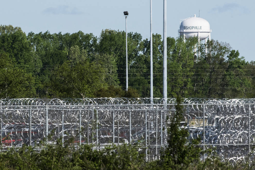 A fence surrounds the Lee Correctional Institution on Monday, April 16, 2018, in Bishopville, South Carolina. Seven inmates were killed and 17 others seriously injured amid fighting between prison ...