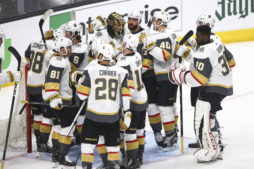 Golden Knights players celebrate their win over the Los Angeles Kings in Game 3 of an NHL hockey first-round playoff series at the Staples Center in Los Angeles on Sunday, April 15, 2018. Chase St ...