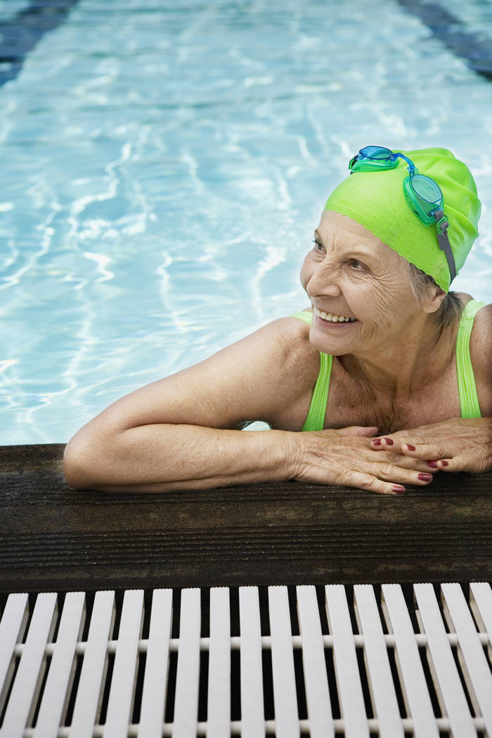 Senior woman swimmer looking away