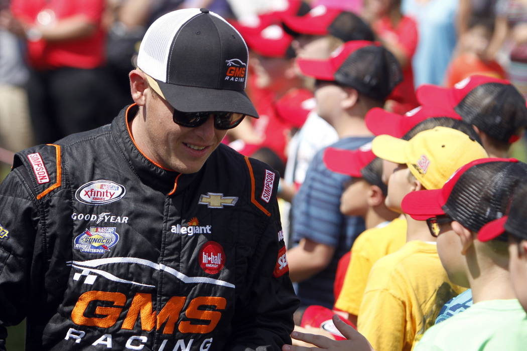 Spencer Gallagher is seen during drivers introductions for the NASCAR Xfinity Series auto race, Saturday, Aug. 12, 2017, at Mid Ohio Sports Car Course in Lexington, OH. (AP Photo/Tom E. Puskar)