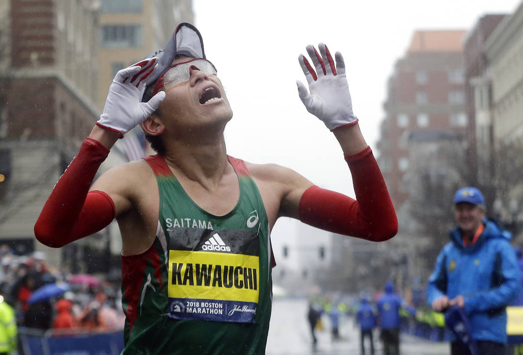 Yuki Kawauchi, of Japan, celebrates after winning the 122nd Boston Marathon on Monday, April 16, 2018, in Boston. He is the first Japanese man to win the race since 1987. (Elise Amendola/AP)