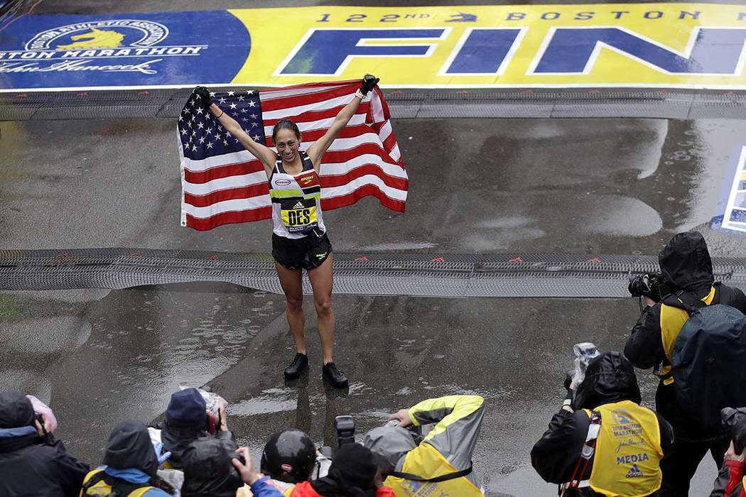 Desiree Linden, of Washington, Michigan, celebrates after winning the women's division of the 122nd Boston Marathon on Monday, April 16, 2018, in Boston. She is the first American woman to win the ...