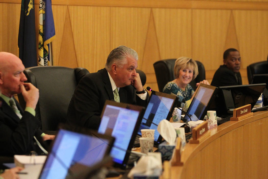 Clark County Commissioners from left, Larry Brown, Steve Sisolak, Susan Brager, and Lawrence Weekly, listen to speakers during a Clark County Commission meeting inside the Clark County Commissione ...