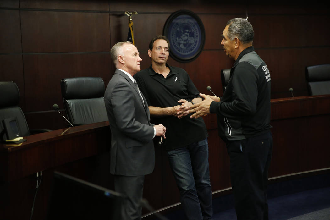 Bob Bennett, from left, executive director of the Nevada Athletic Commission, with boxing promoter Tom Loeffler and trainer Abel Sanchez, during a Nevada Athletic Commission meeting at the Grant S ...