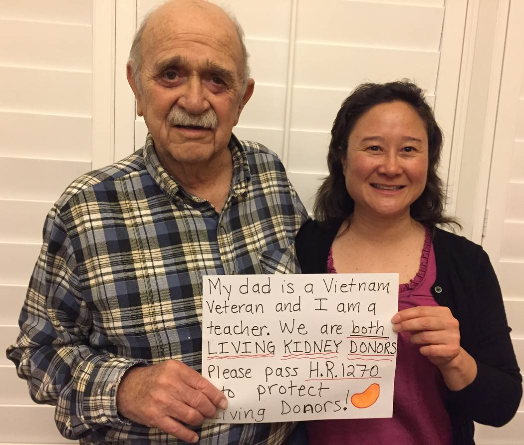 June Monroe, right, and her father pose for a photo for social media that advocates for more legal protections for living organ donors. (June Monroe)