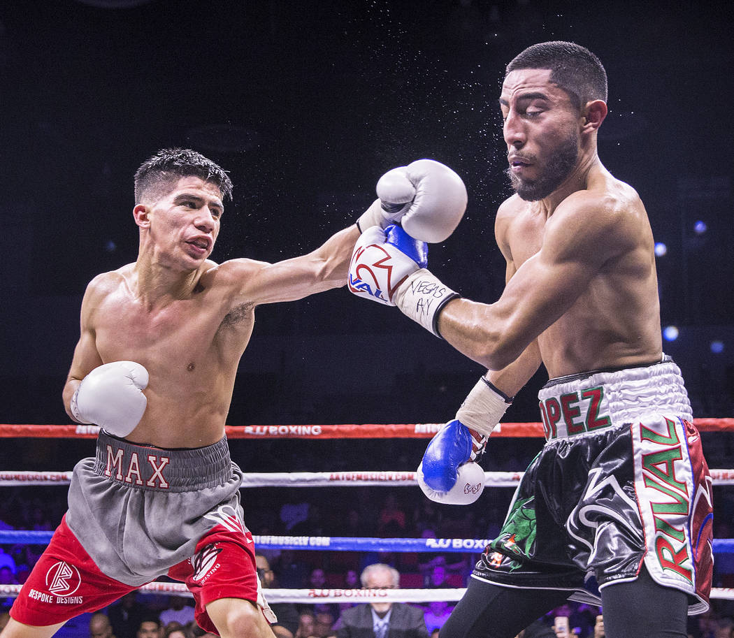 Max Ornelas, left, lands a left hook against Tony Lopez during their bantamweight boxing match on Friday, April 20, 2018, at Cox Pavilion, in Las Vegas. Ornelas defeated Lopez by unanimous decisio ...