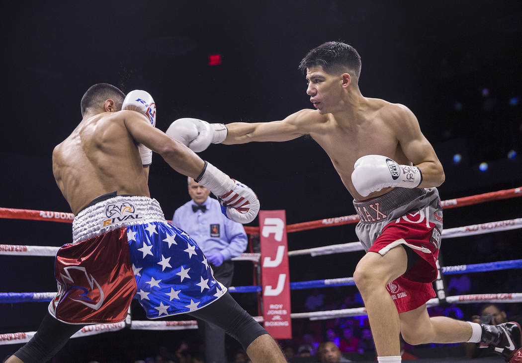 Max Ornelas, right, lands a right hook against Tony Lopez during their bantamweight boxing match on Friday, April 20, 2018, at Cox Pavilion, in Las Vegas. Ornelas defeated Lopez by unanimous decis ...