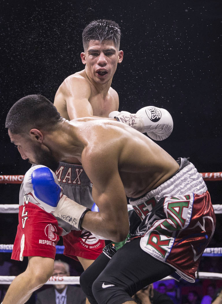Max Ornelas, top, lands a right hook against Tony Lopez during their bantamweight boxing match on Friday, April 20, 2018, at Cox Pavilion, in Las Vegas. Ornelas defeated Lopez by unanimous decisio ...
