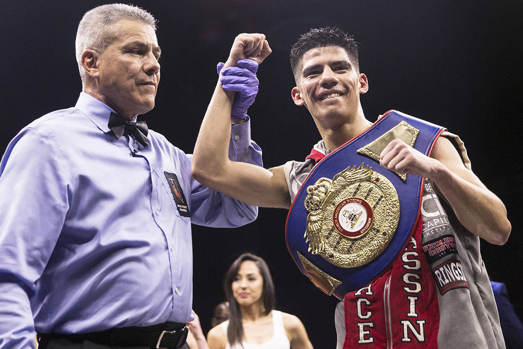 Max Ornelas, right, celebrates after defeating Tony Lopez by unanimous decision in eight rounds on Friday, April 20, 2018, at Cox Pavilion, in Las Vegas. Benjamin Hager Las Vegas Review-Journal @b ...