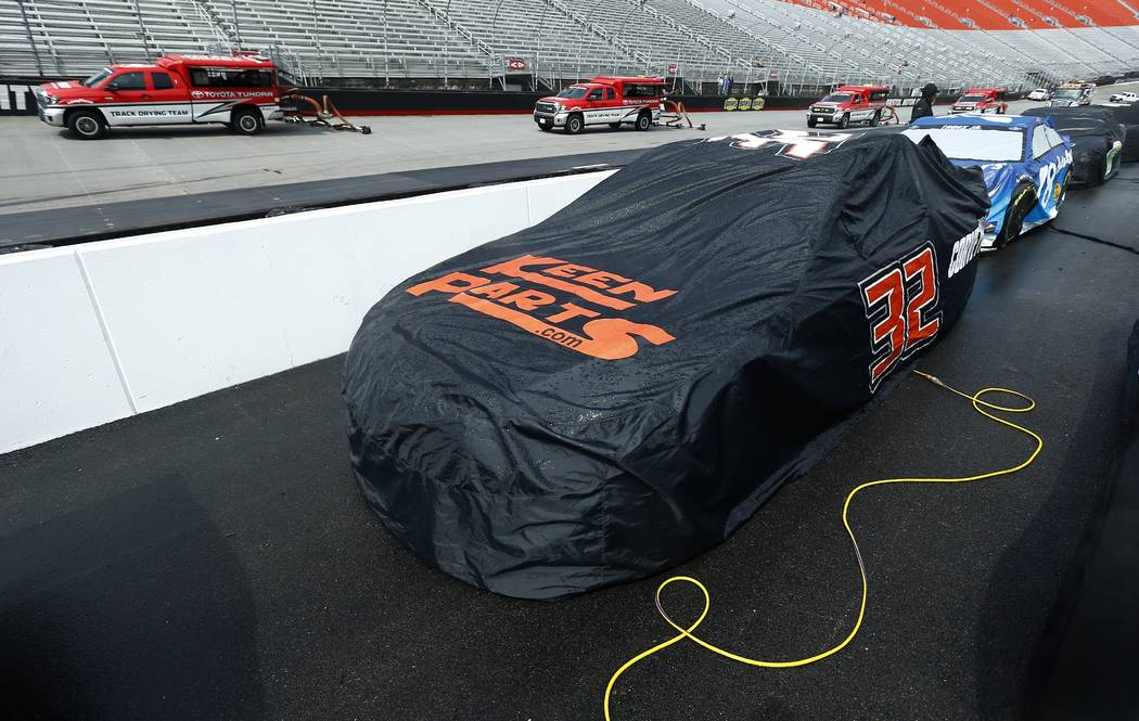 Dryers make their way around the track as cars sit covered before a NASCAR Cup Series auto race, Monday, April 16, 2018, in Bristol, Tenn. Kyle Larson leads with 296 laps left in the 500-lap race ...