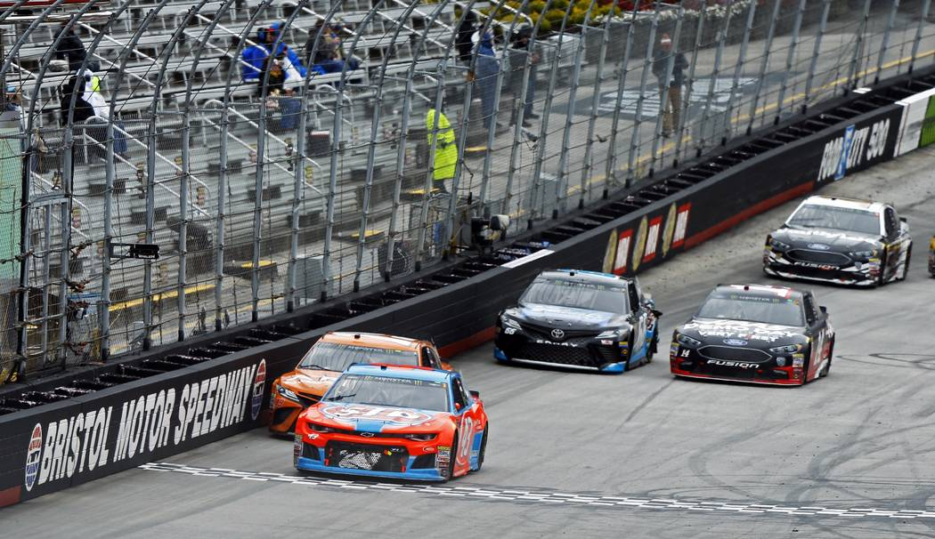 Bubba Wallace (43) leads Daniel Suarez (19), Clint Bowyer (14), Chad Finchum (66) and Aric Almirola (10) during a NASCAR Cup Series auto race, Monday, April 16, 2018, in Bristol, Tenn. (AP Photo/W ...