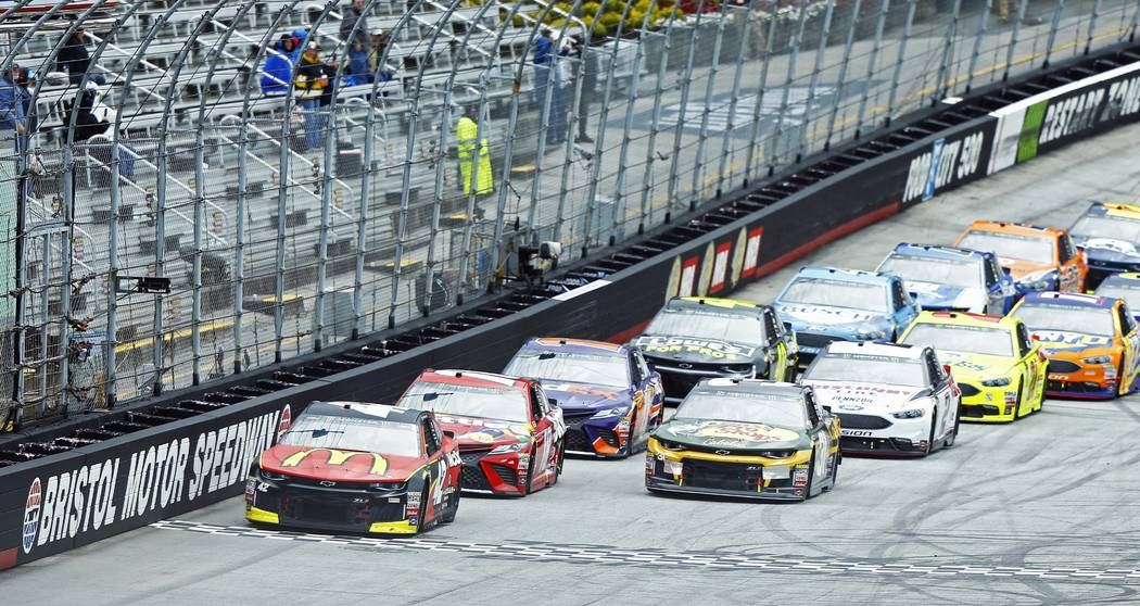 Kyle Larson (42) leads the field to start/finish line for the continuation of a NASCAR Cup Series auto race, Monday, April 16, 2018 in Bristol, Tenn., after it was called Sunday due to inclement ...