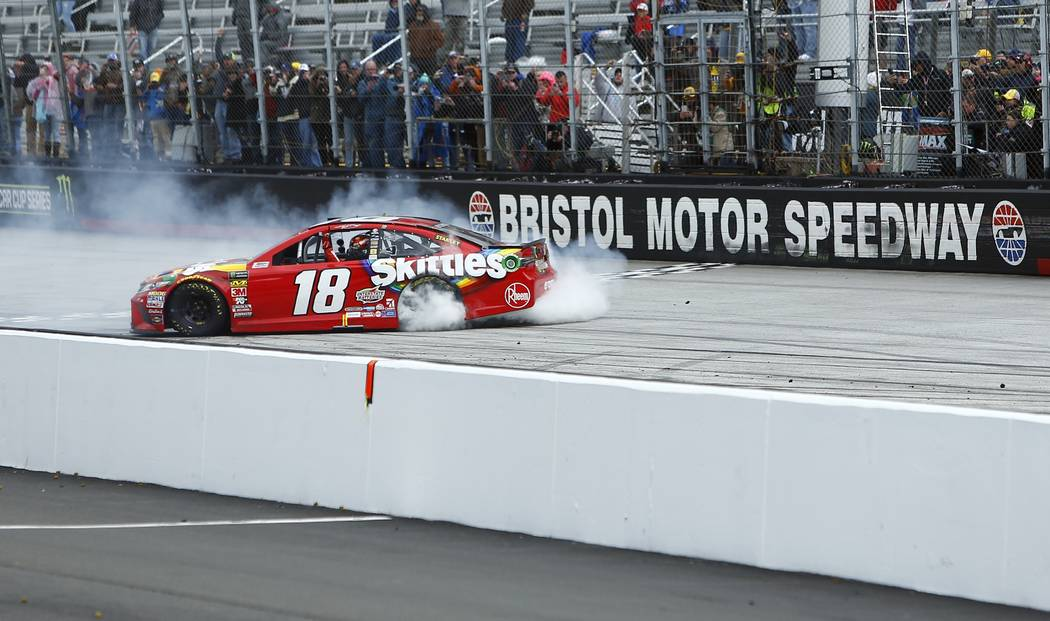 Kyle Busch does a burnout after winning during a NASCAR Cup Series auto race, Monday, April 16, 2018, in Bristol, Tenn. (AP Photo/Wade Payne)
