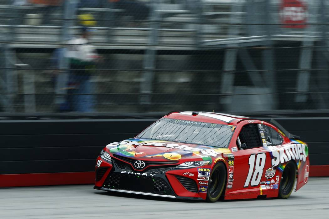 Kyle Busch leads during a NASCAR Cup Series auto race, Sunday, April 15, 2018, in Bristol, Tenn. (AP Photo/Wade Payne)