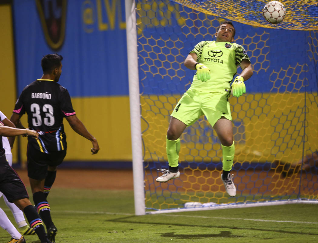 San Antonio FC goalkeeper Diego Restrepo (24) blocks the ball from Las Vegas Lights FC defender Miguel Garduño (33) during the second half of a United Soccer League game at Cashman Field in L ...