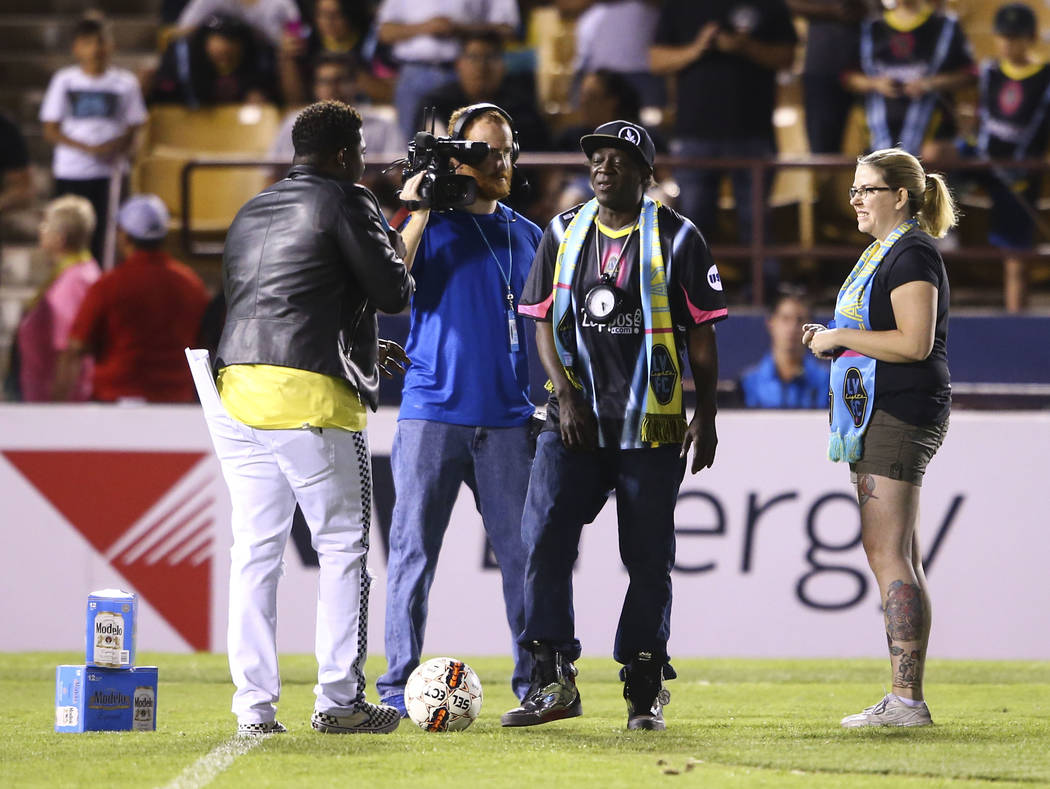 Flavor Flav, center right, appears during halftime of a United Soccer League game between the Las Vegas Lights FC and San Antonio FC at Cashman Field in Las Vegas on Friday, April 27, 2018. Chase ...