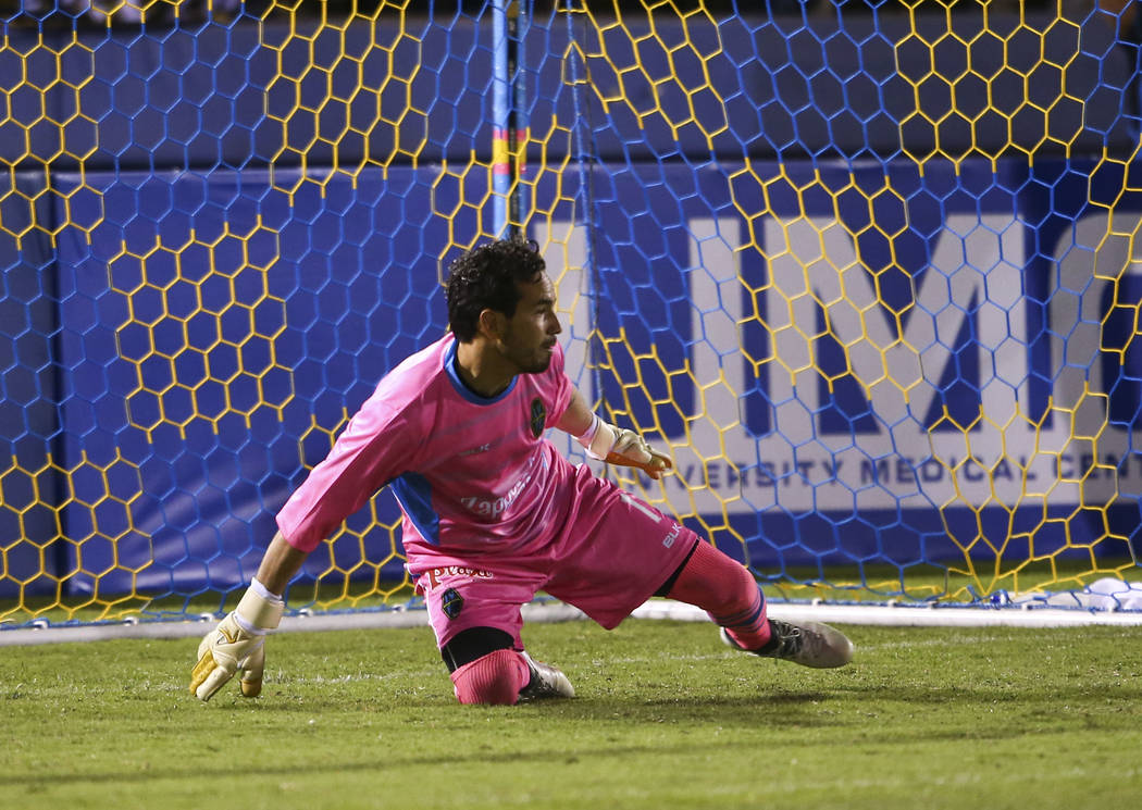 Las Vegas Lights FC goalkeeper Ricardo Ferriño (1) tries to block a shot from San Antonio FC during the second half of a United Soccer League game at Cashman Field in Las Vegas on F ...