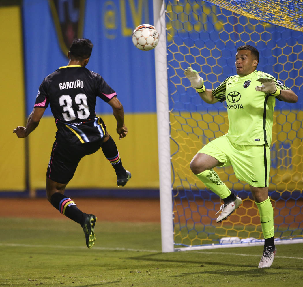 Las Vegas Lights FC defender Miguel Garduño (33) heads the ball against San Antonio FC goalkeeper Diego Restrepo (24) during the second half of a United Soccer League game at Cashman Fie ...