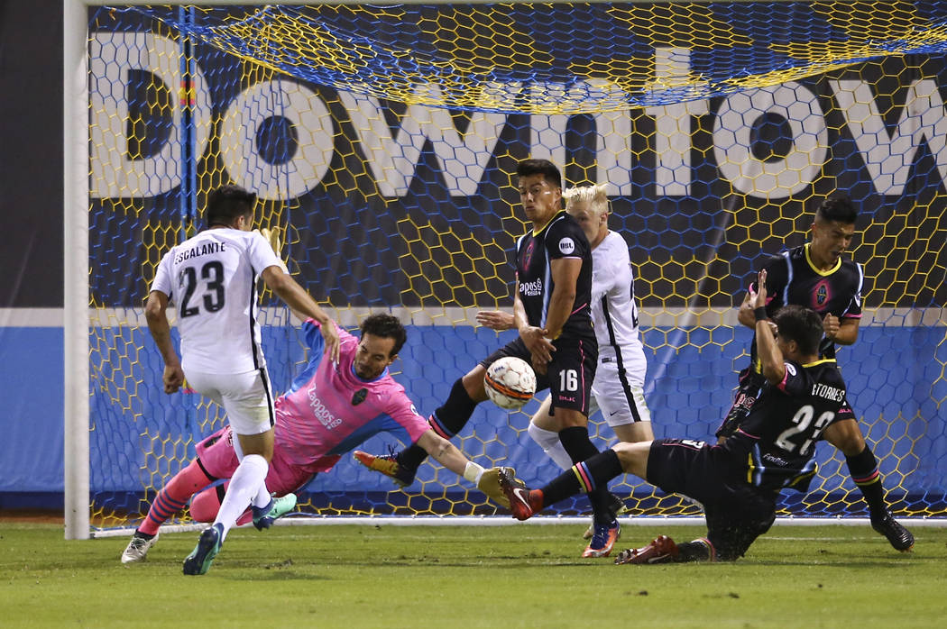 San Antonio FC midfielder Jose Escalante (23) scores a goal past Las Vegas Lights FC goalkeeper Ricardo Ferriño (1) during the first half of a United Soccer League game at Cashman Field in Las Ve ...