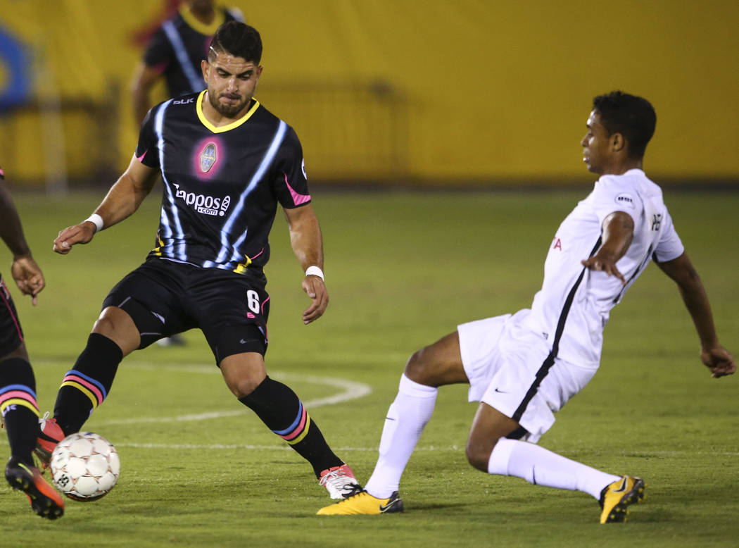 Las Vegas Lights FC defender Marco Cesar Jaime Jr. (6) moves the ball in front of San Antonio FC midfielder Pecka (8) during the first half of a United Soccer League game at Cashman Field in Las V ...