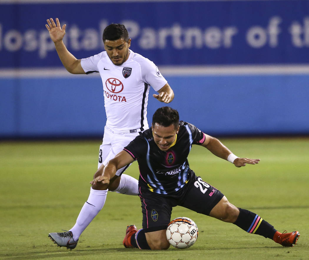 Las Vegas Lights FC midfielder Julian Portugal (26) moves the ball in front of San Antonio FC midfielder Sonny Guadarrama (33) during the first half of a United Soccer League game at Cashman Field ...