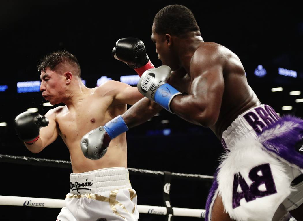 Adrien Broner, right, follows through on a right to Jessie Vargas during the third round of a welterweight boxing match Saturday, April 21, 2018, in New York. (AP Photo/Frank Franklin II)