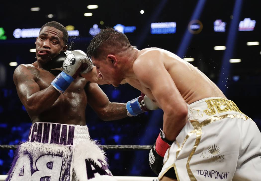 Jessie Vargas, right, punches Adrien Broner during the 10th round of a welterweight boxing match Saturday, April 21, 2018, in New York. The match ended in a draw. (AP Photo/Frank Franklin II)