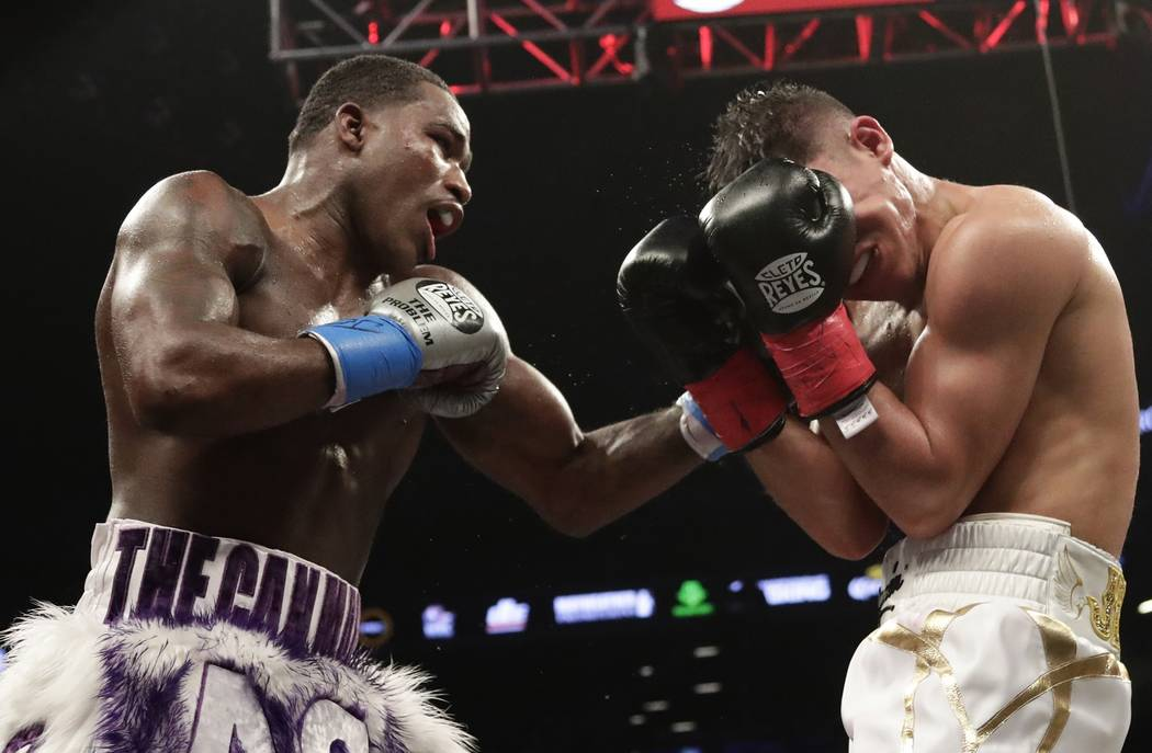 Adrien Broner,, left, punches Jessie Vargas during the eighth round of a welterweight boxing match Saturday, April 21, 2018, in New York. (AP Photo/Frank Franklin II)