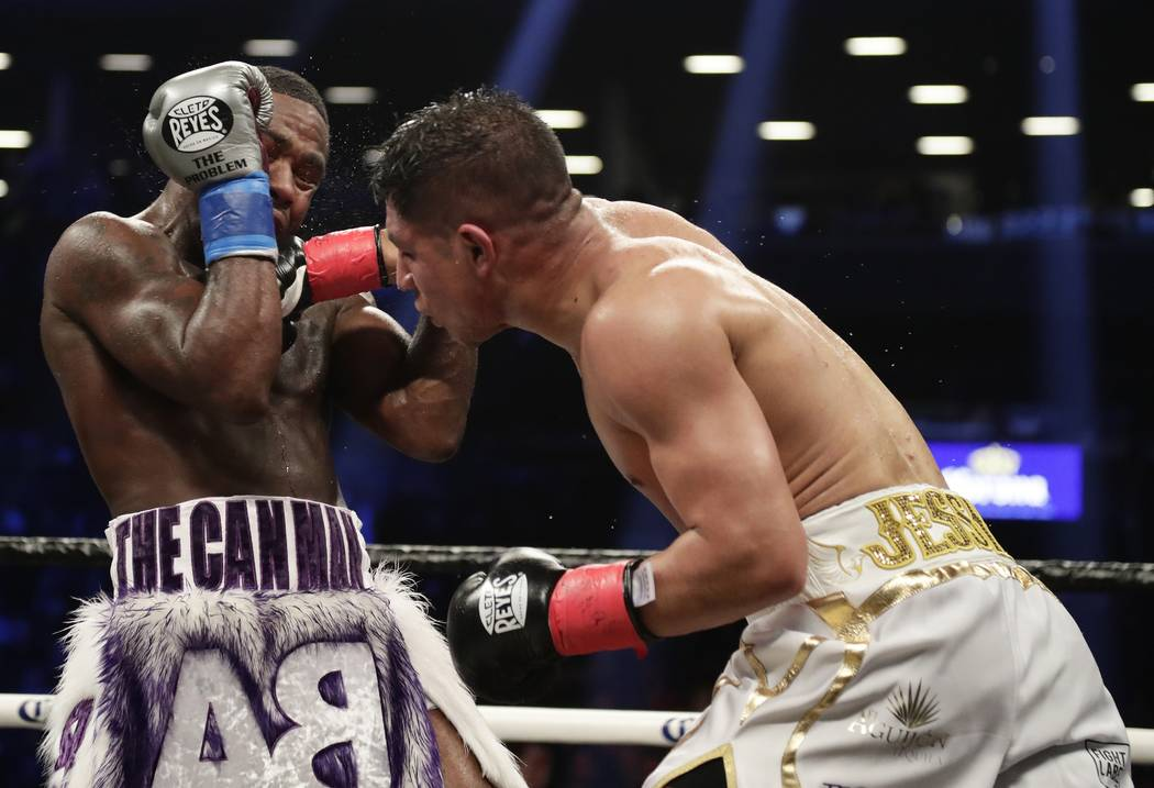 Jessie Vargas, right, punches Adrien Broner during the ninth round of a welterweight boxing match Saturday, April 21, 2018, in New York. (AP Photo/Frank Franklin II)
