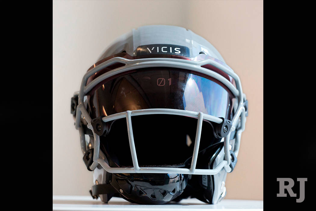 In this Sept. 11, 2017, file photo, a VICIS Zero1 helmet is displayed in New York. The NFL for the first time is prohibiting certain helmets from being worn by players. (AP Photo/Mark Lennihan, File)