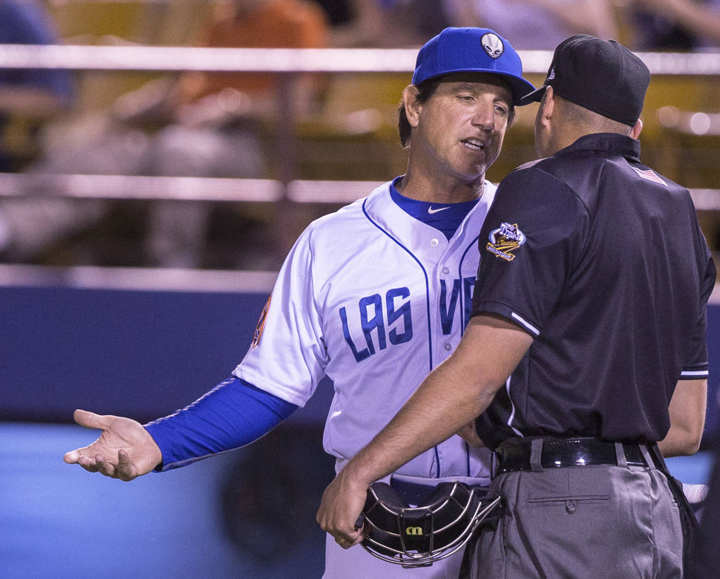 51s manager Tony DeFrancesco, left, argues a call during Las Vegas' home matchup with the El Paso Chihuahuas on Monday, April 9, 2018, at Cashman Field, in Las Vegas. Benjamin Hager Las Vegas Revi ...