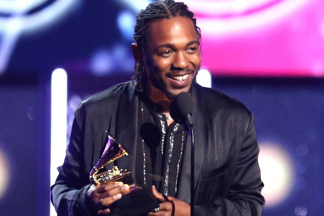 "In this Jan. 28, 2018 file photo, rapper Kendrick Lamar accepts the award for best rap album for ""Damn"" at the 60th annual Grammy Awards in New York. On Monday, April 16, 2018, Lamar won the Pulit ..."