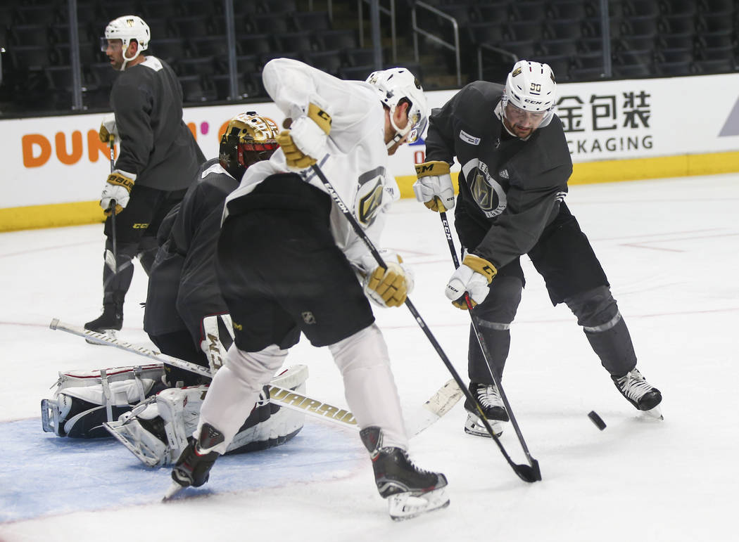 Golden Knights left wing Tomas Tatar, right, looks to shoot as Knights center Oscar Lindberg and goaltender Malcolm Subban defend during practice ahead of Game 4 against the Los Angeles Kings, sla ...