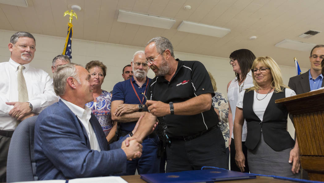 U.S. Secretary of the Interior Ryan Zinke, left, shakes Chairman Dan Schinhofen of the Board of County Commissioners at the Bob Ruud Community Center in Pahrump, Monday, June 26, 2017. Elizabeth B ...
