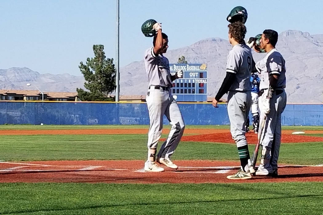 Palo Verde's Jaret Godman, left, is congratulated by teammates after hitting a two-run home run in the fourth inning at Centennial High School in Las Vegas on Monday, April 16, 2018. Centennial ra ...