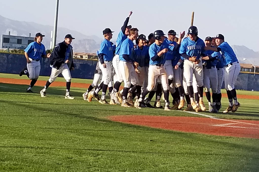 Centennial players celebrate after Kris Bow's walk-off double in the bottom of the seventh inning against Palo Verde on Monday, April 16, 2018. The Bulldogs beat the Panthers, 15-14. (Damon Seiter ...