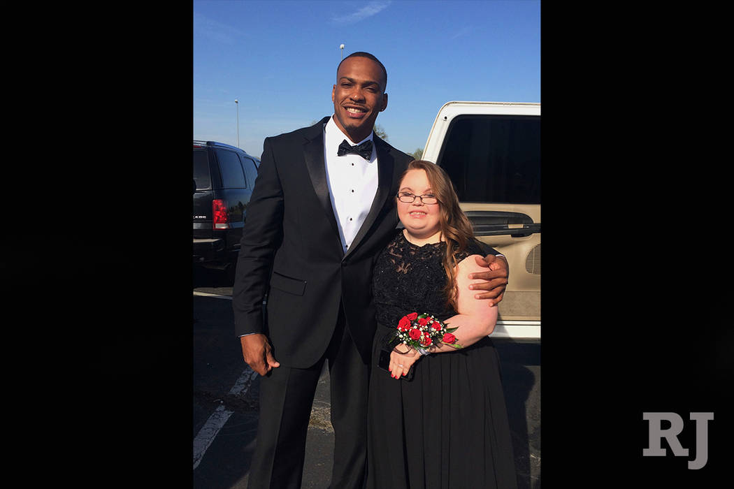 This photo taken April 13, 2018 by Kristi Martin, shows her daughter Lindsey Preston, next to NFL player Don Jones at Preston's prom in Moulton, Ala. Jones a defensive back for the San Francisco 4 ...