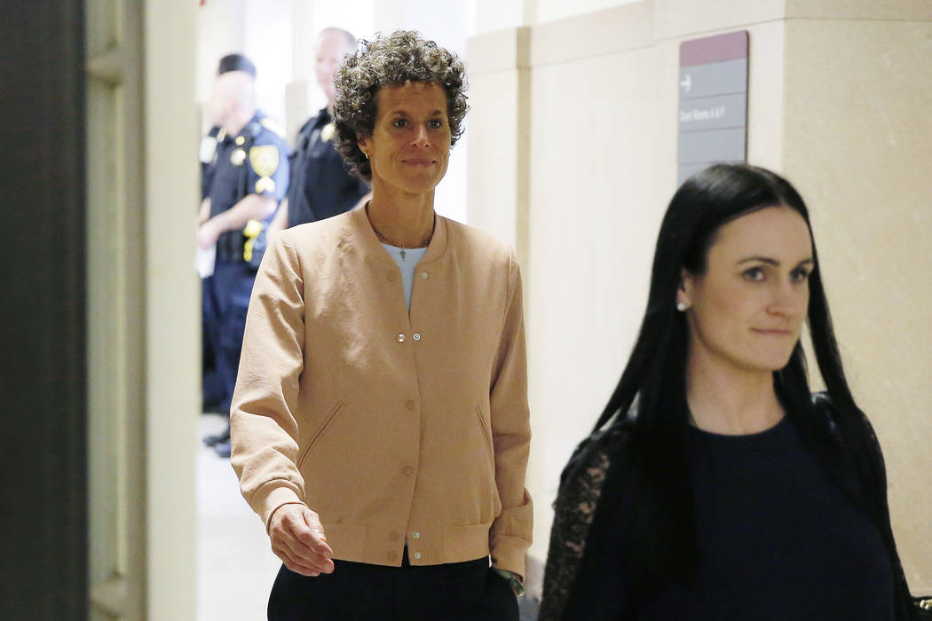 Andrea Constand, left, returns to the courtroom after a lunch break during Bill Cosby's sexual assault retrial at the Montgomery County Courthouse in Norristown, Pa., Monday, April 16, 2018. (Domi ...