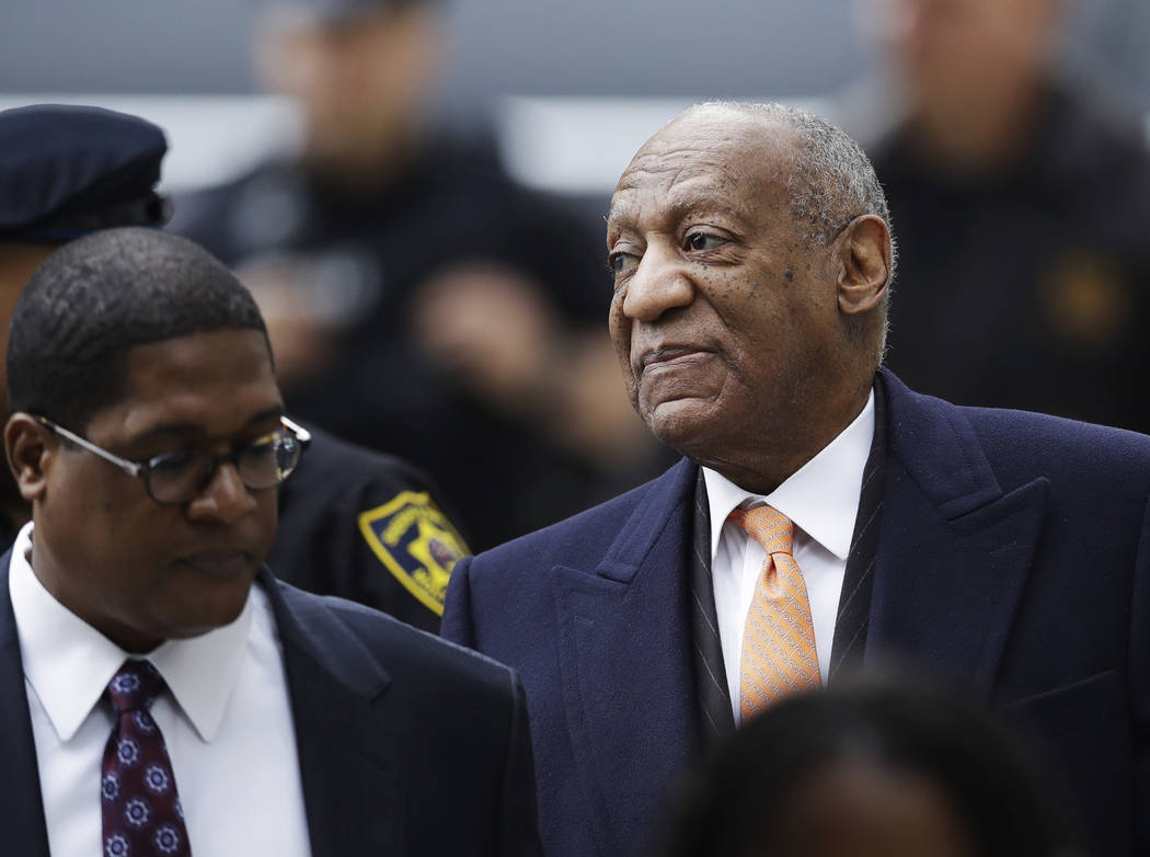 Bill Cosby, right, arrives for his sexual assault trial, Tuesday, April 17, 2018, at the Montgomery County Courthouse in Norristown, Pa. (Matt Slocum/AP)
