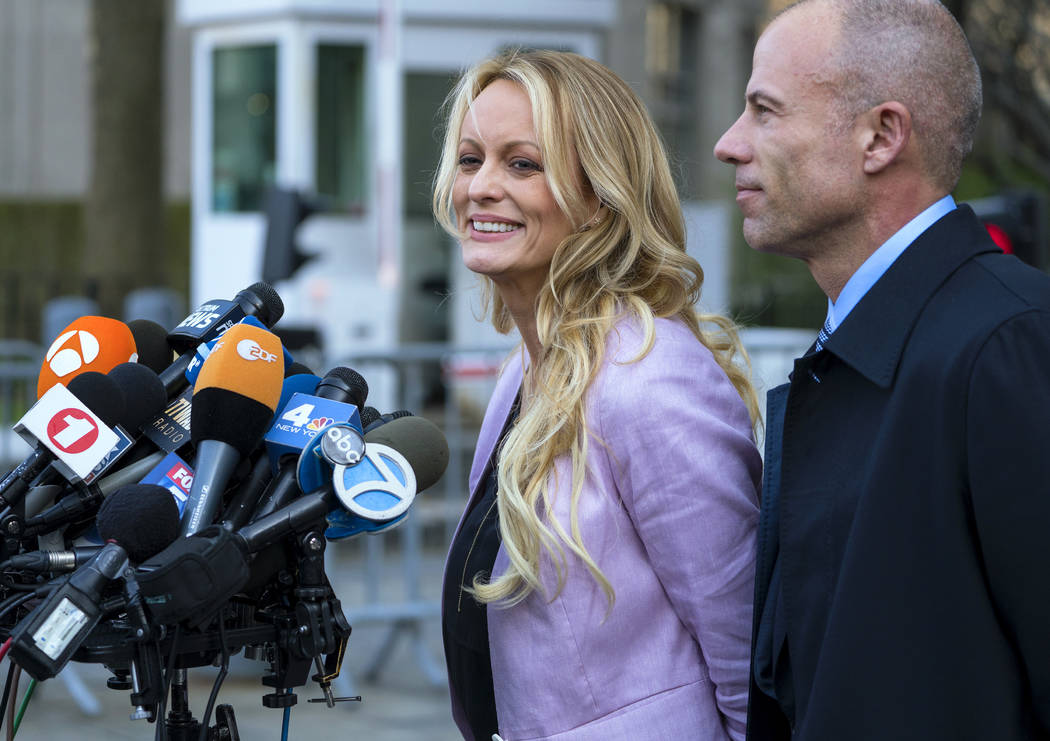 Adult film actress Stormy Daniels speaks to members of the media after a hearing at federal court, Monday, April 16, 2018, in New York, as she is accompanied by her attorney Michael Avenatti. (Cr ...