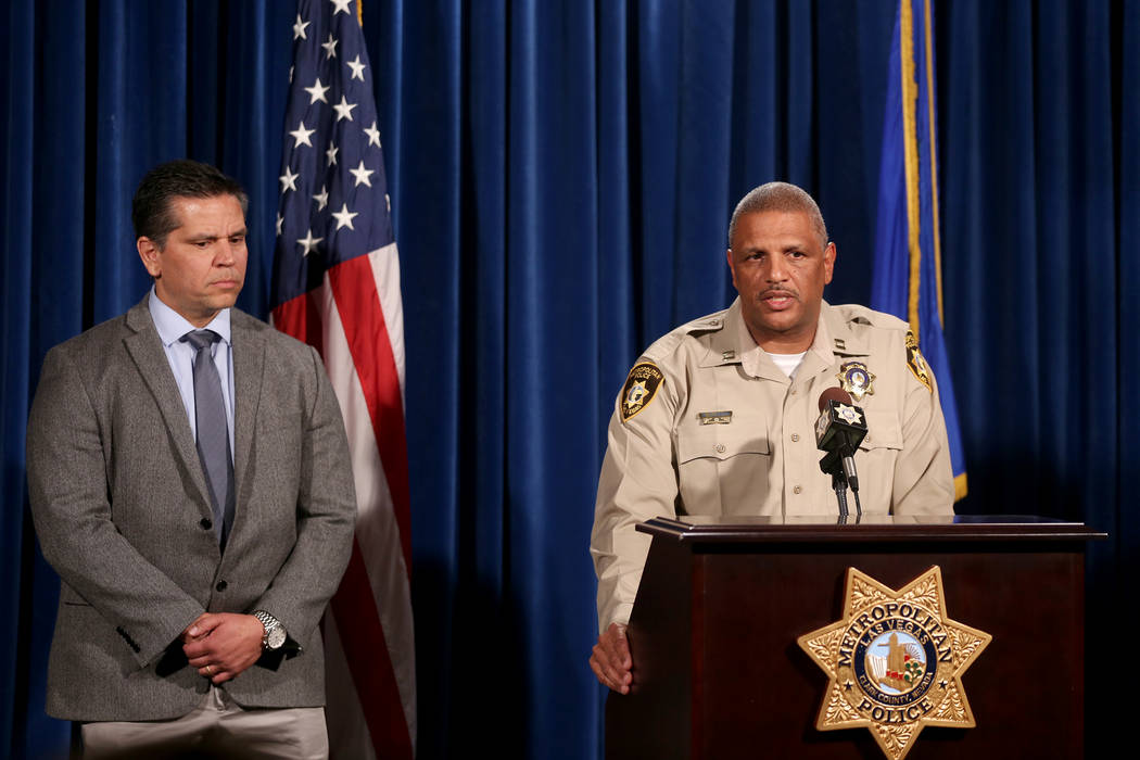 Homicide Captain Robert Plummer discusses the violent incident that took place Sunday night at Sunset Park as Supervisory Special Agent Jose Perez listens at LVMPD Headquarters in Las Vegas, Tuesd ...