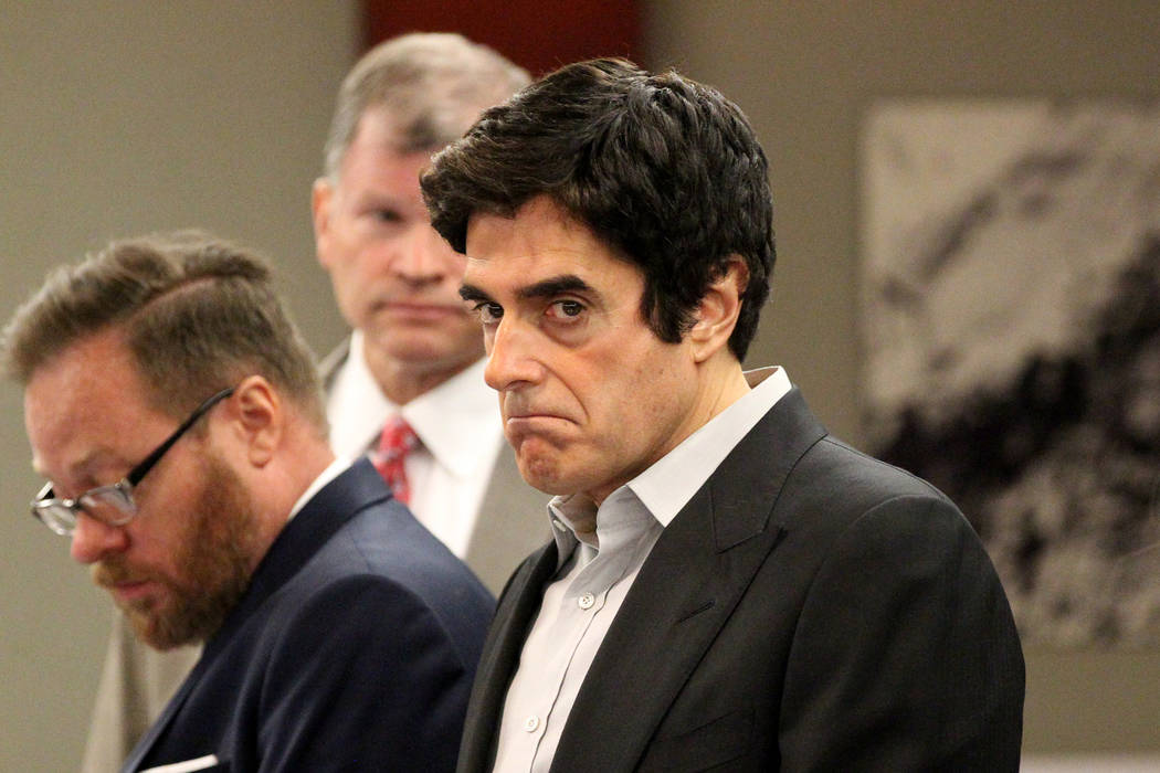 David Copperfield, third from left, appears during his civil trial at the Regional Justice Center in Las Vegas Tuesday, April 17, 2018. A British man was injured during a magic trick where Copperf ...