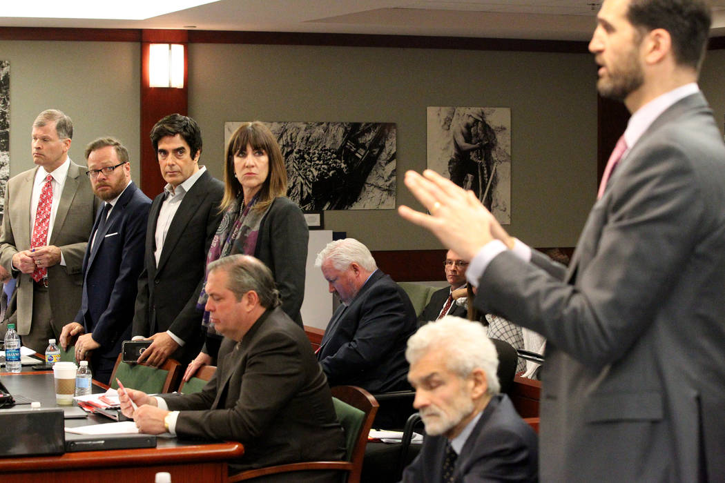 David Copperfield, third from left, listens during his civil trial at the Regional Justice Center in Las Vegas Tuesday, April 17, 2018, to Adam Deutsch, right, attorney for a British man who was i ...