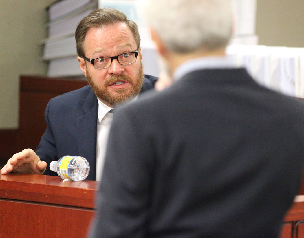 Chris Kenner president of Backstage Employment & Referral Inc. and executive producer for David Copperfield, left, answers a question during Copperfield's civil trial at the Regional Justice C ...