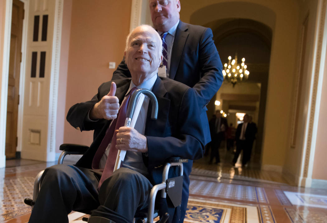 Sen. John McCain, R-Ariz., leaves a closed-door session on Capitol Hill in Washington, Dec. 1, 2017. McCain's office said Monday, April 16, 2018, he is in stable condition at a Phoenix hospital af ...